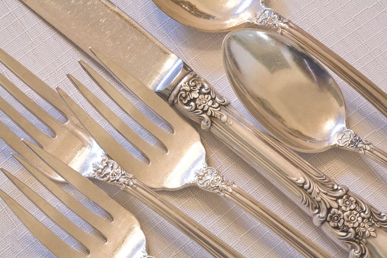 fine dining elegant antique silverware place setting