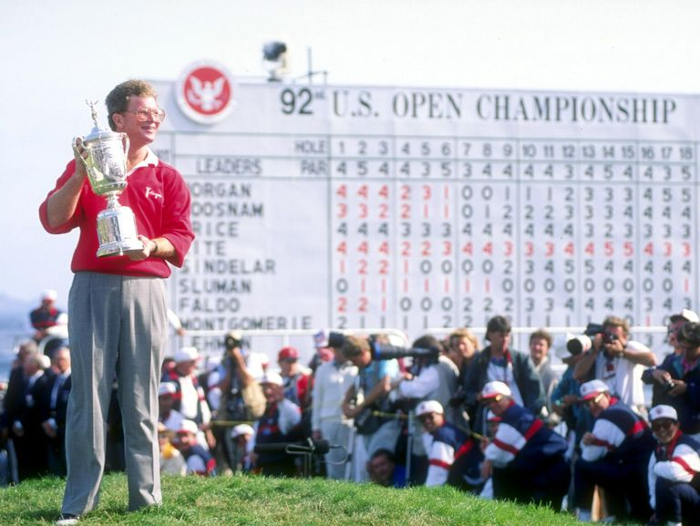Tom Kite displays the US Open trophy he won in 1992.