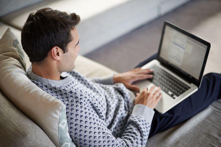 Man using laptop at home