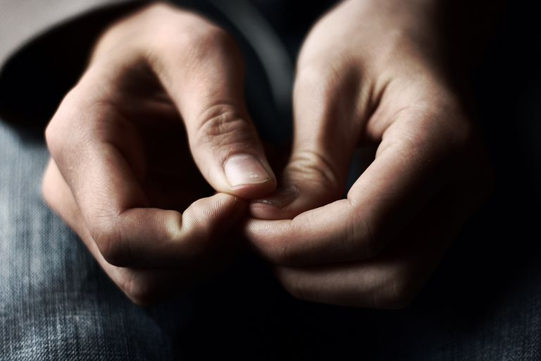 close up of anxious person's hands