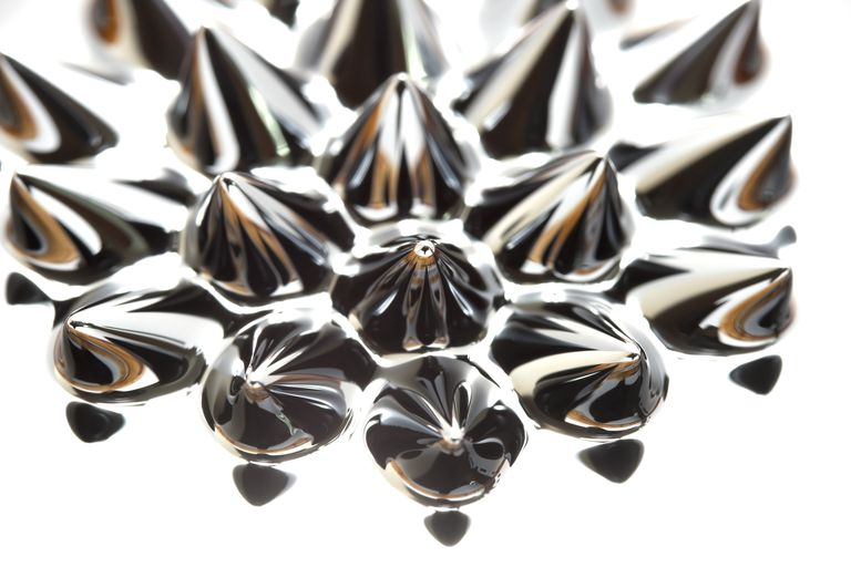 The spiky appearance of ferrofluid is caused by the material trying to follow magnetic field lines.