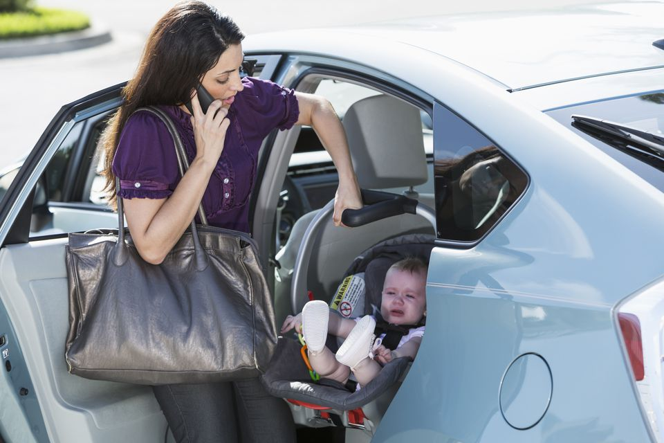 Woman traveling with baby on phone