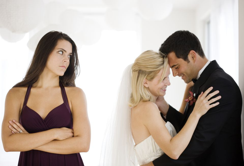 Bitter bridesmaid next to romantic bride and groom