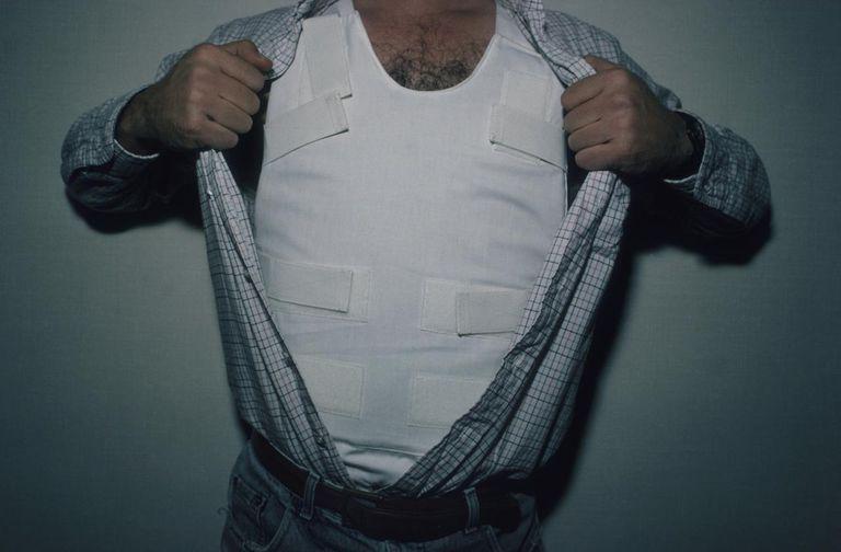 Man Showing Bulletproof Vest