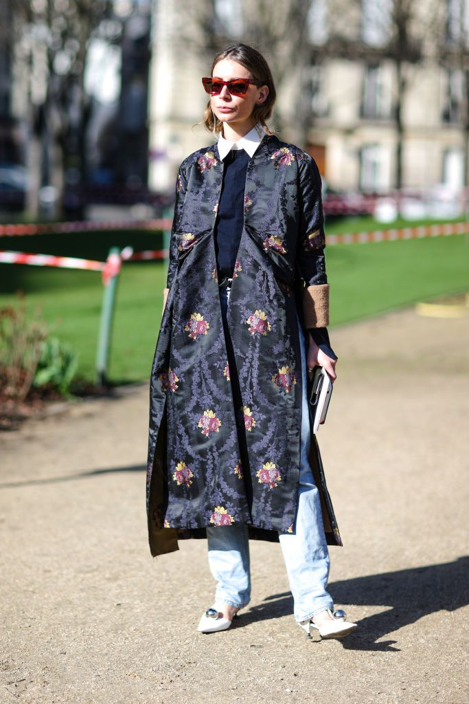 Street style in tapestry print winter coat and jeans