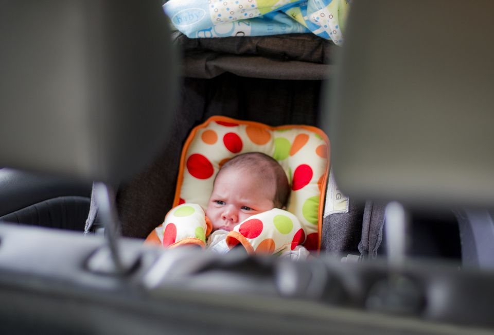 Baby with thick car seat cover