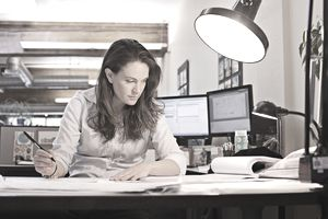 woman writing at office desk