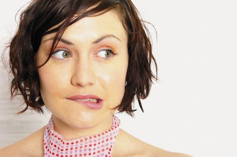 Woman biting lip feeling guilty
