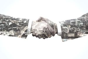 men shaking hands with cityscape imposed on hands