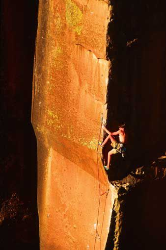 Ian Spencer-Green working up the sheer arête of Bullet the Blue Sky (5.12d) at Penitente Canyon.