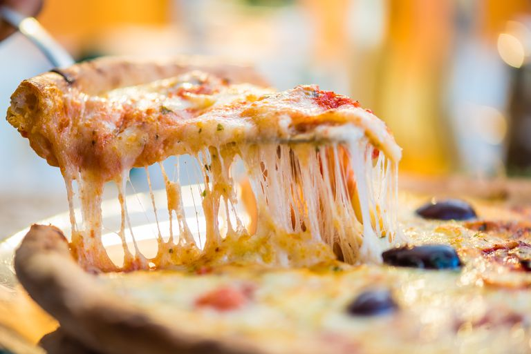 Close-up of pizza slice on spatula.