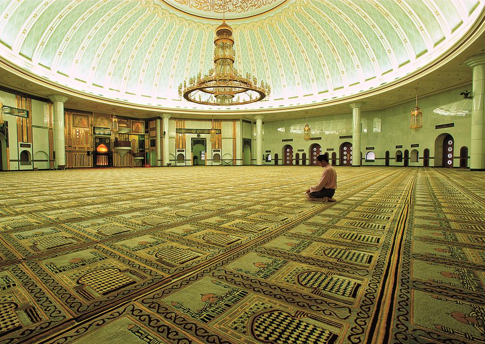 Man praying at mosque in Bandar Seri Begawan, Brunei
