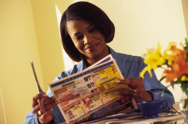 Woman clipping coupons
