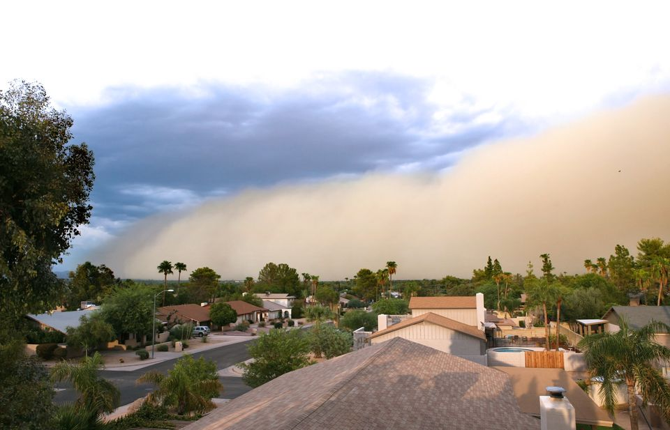 Dust storm rolling over residential area