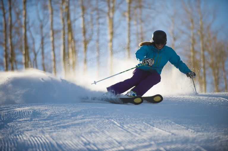 A Woman Skiing Groomers