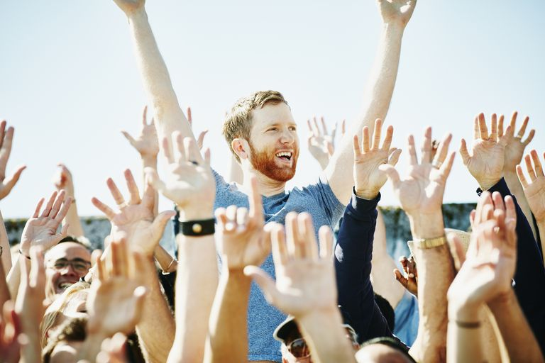 Man cheering in crowd