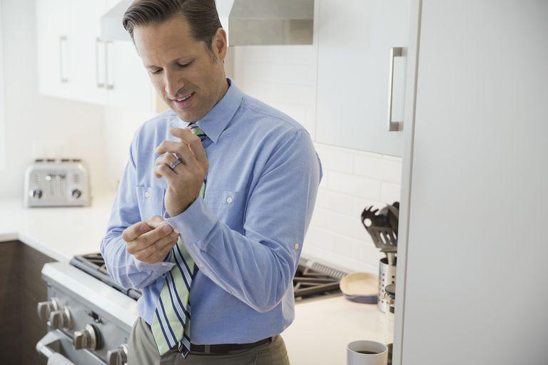 Businessman buttoning dress shirt