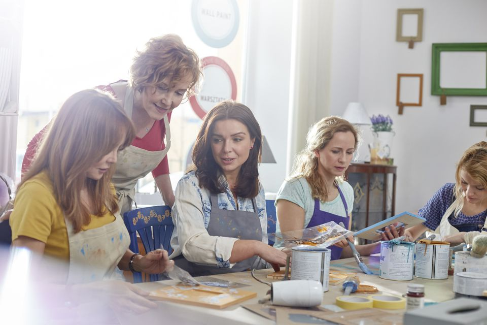Female artists painting in art class workshop
