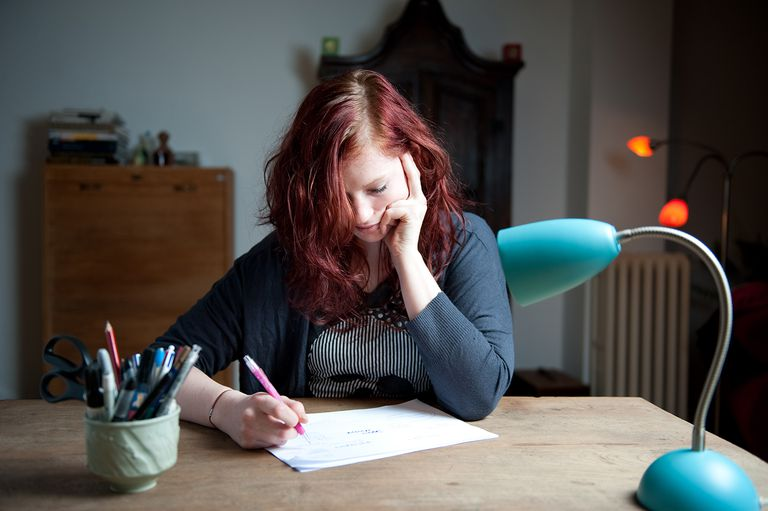 Young woman writing a brainstorm for her letter.