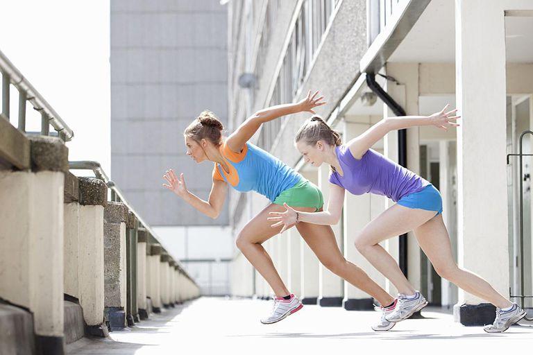 Women running on city street