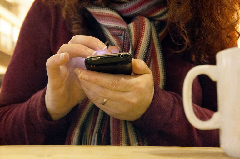 Woman using a cell phone.