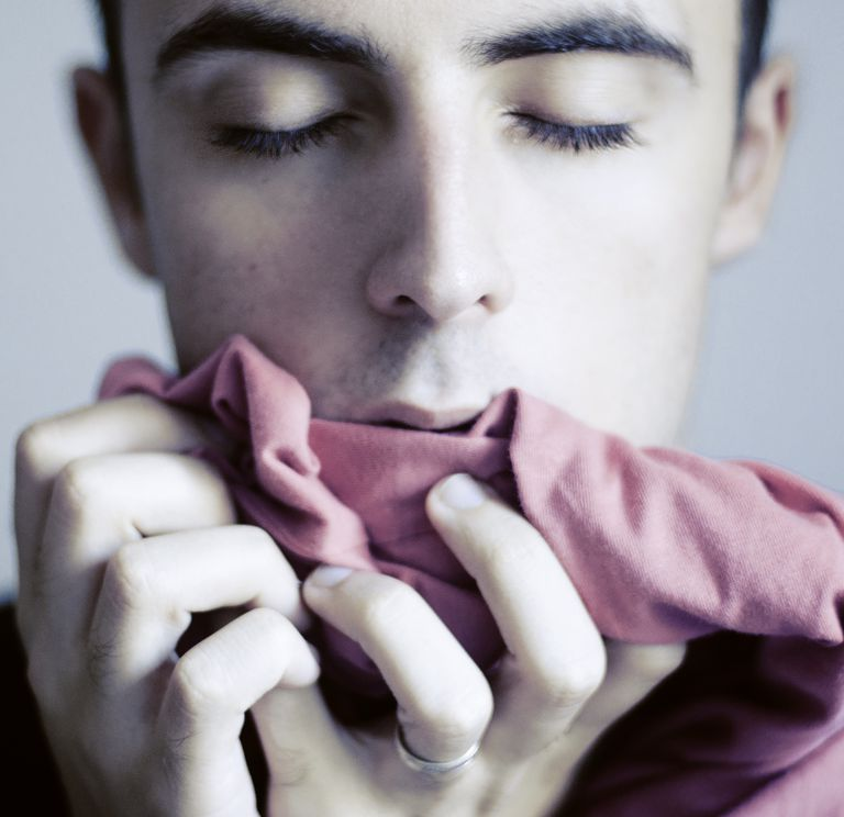 Man_smelling-Perfumed_Clothes