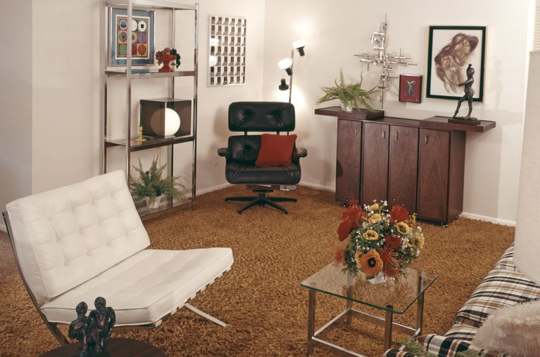 Living Room with a white Barcelona chair and black Eames style lounge chair