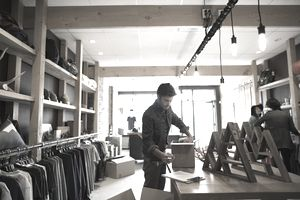 Worker unpacking new inventory in clothing shop