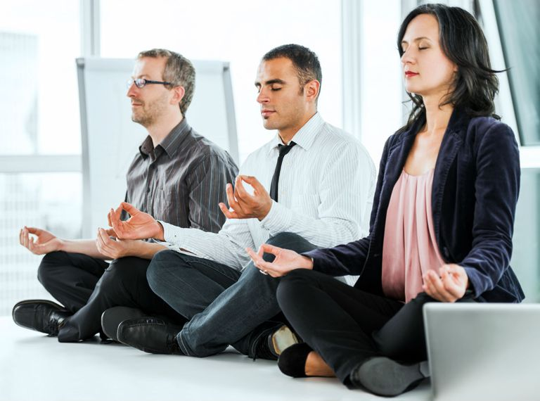 Business professionals meditating