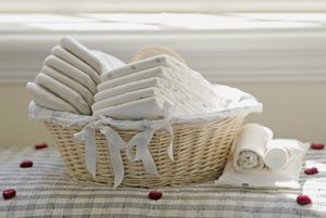 Nappies in wicker basket in front of window sill