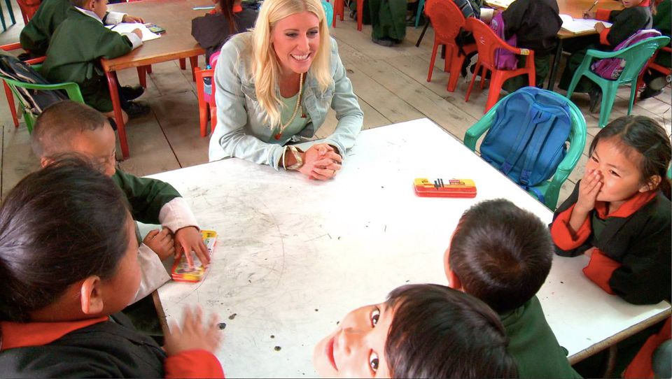 The author practicing what she preaches at a school in Cambodia.