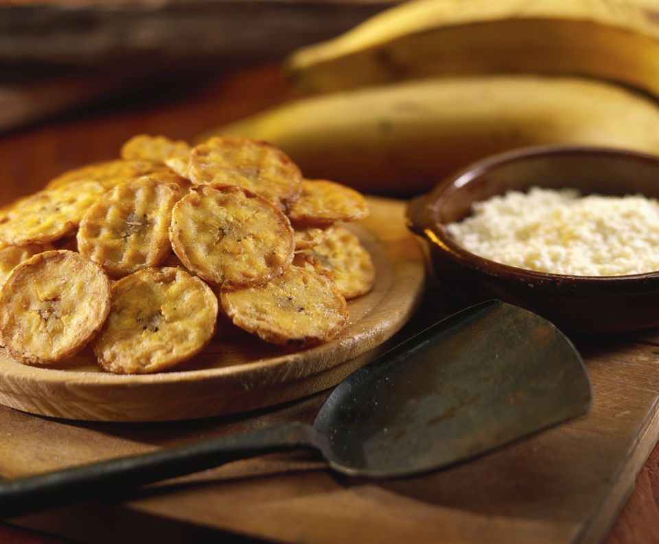 Tostones (banana crisps with white cheese, Venezuela)
