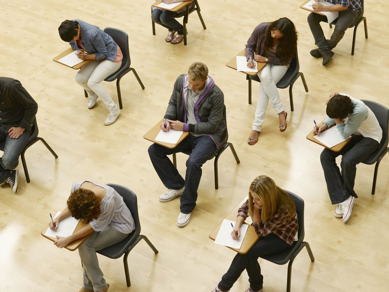 College students taking test in classroom