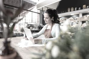 Woman doing the books at a restaurant