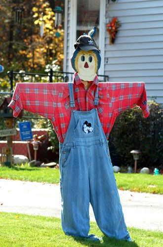 The scarecrow in this picture uses wood as a frame. Wood framework draped with scarecrow clothes.