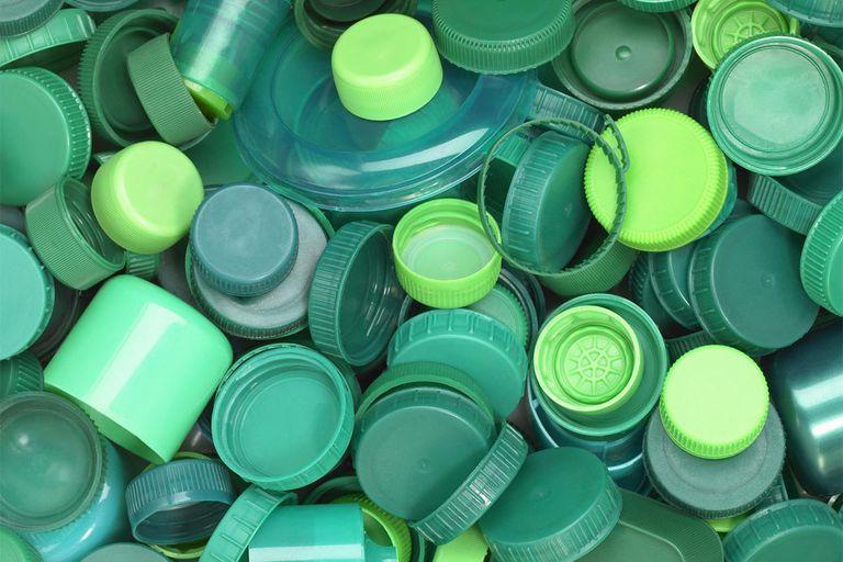 Green plastic lids close up.