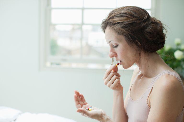 woman taking medication