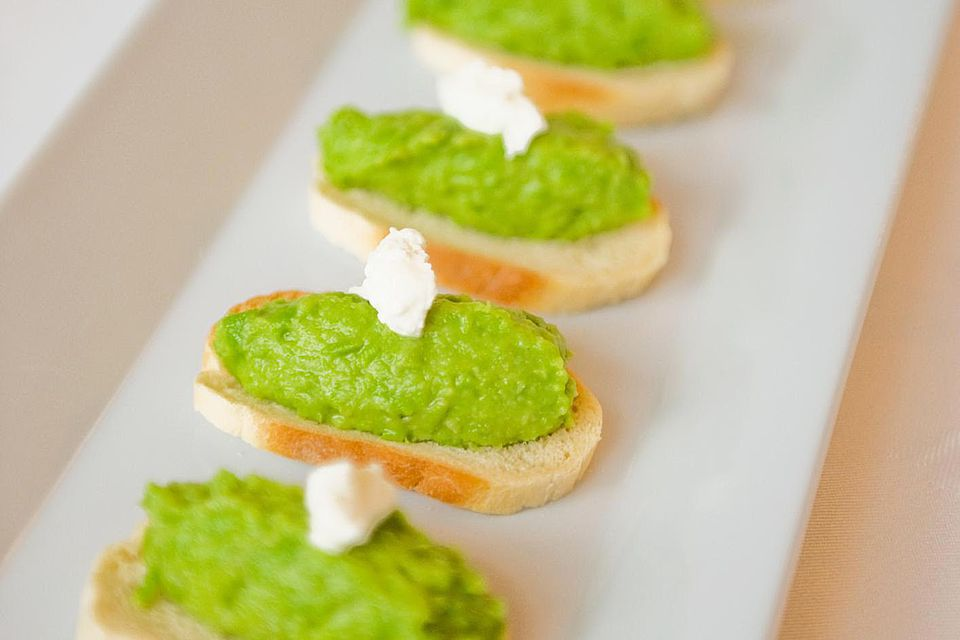 Canape pea puree on french bread