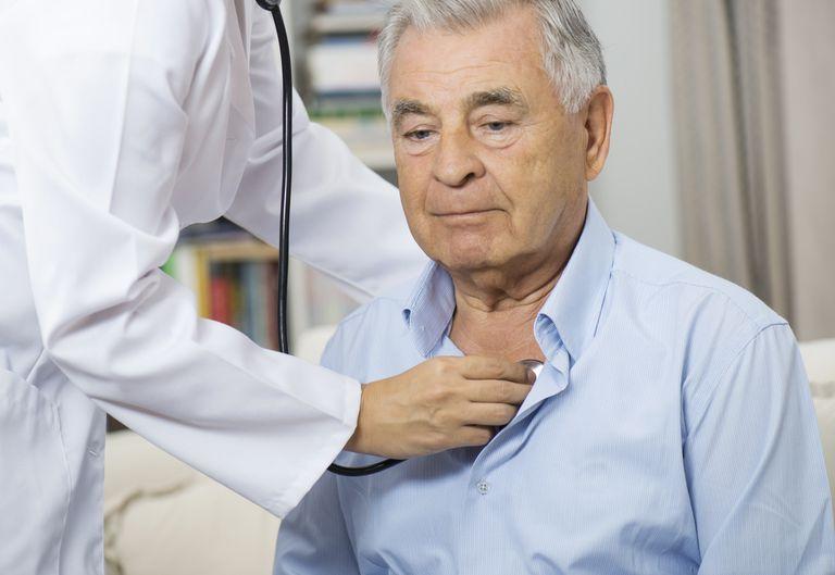 Medical Caring For Senior Man At Home