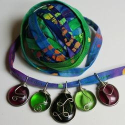 Rag Ball With Wire-Wrapped Pendants Strung Onto It
