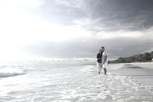 Couple standing in the water at the beach