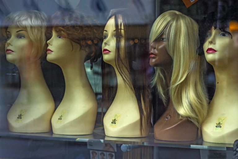 Mannequins and wigs in store window