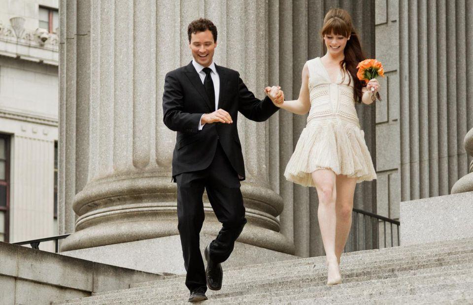 Newlywed couple descending steps together