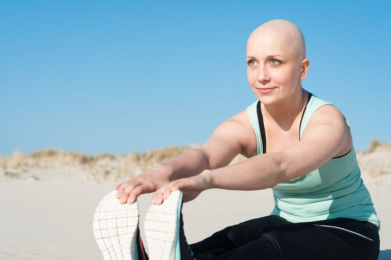 young woman with bald head doing sports