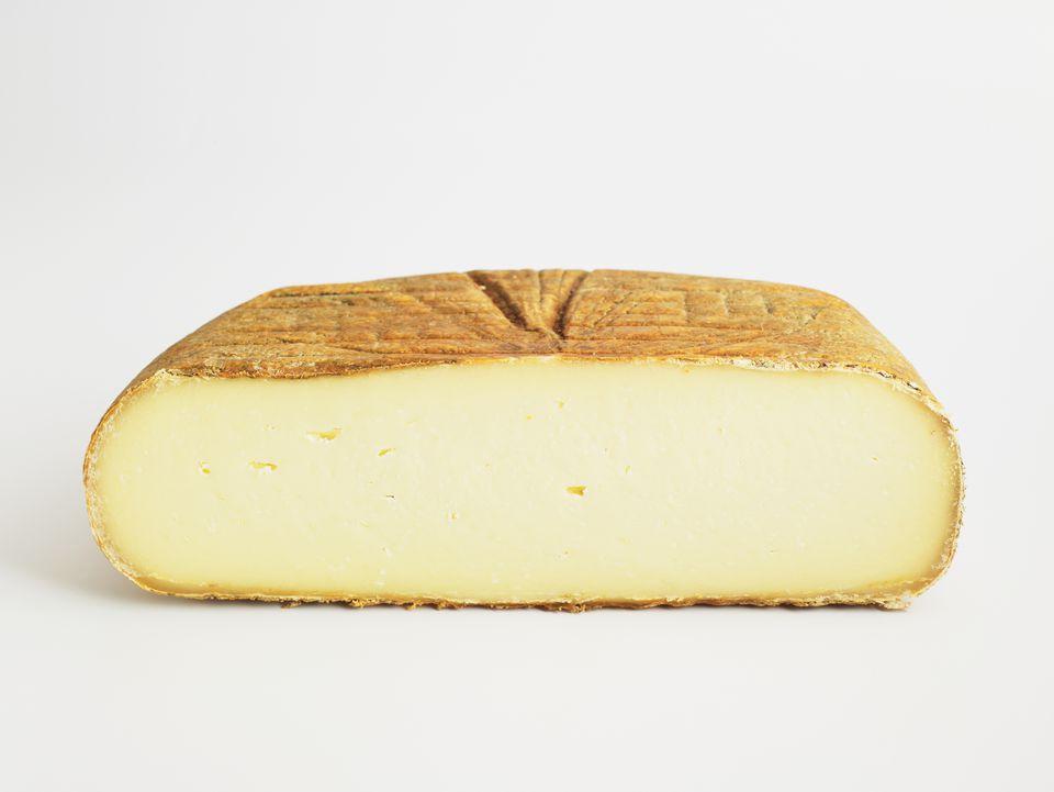 Sliced cushion of Spanish Mahon cow�s milk cheese