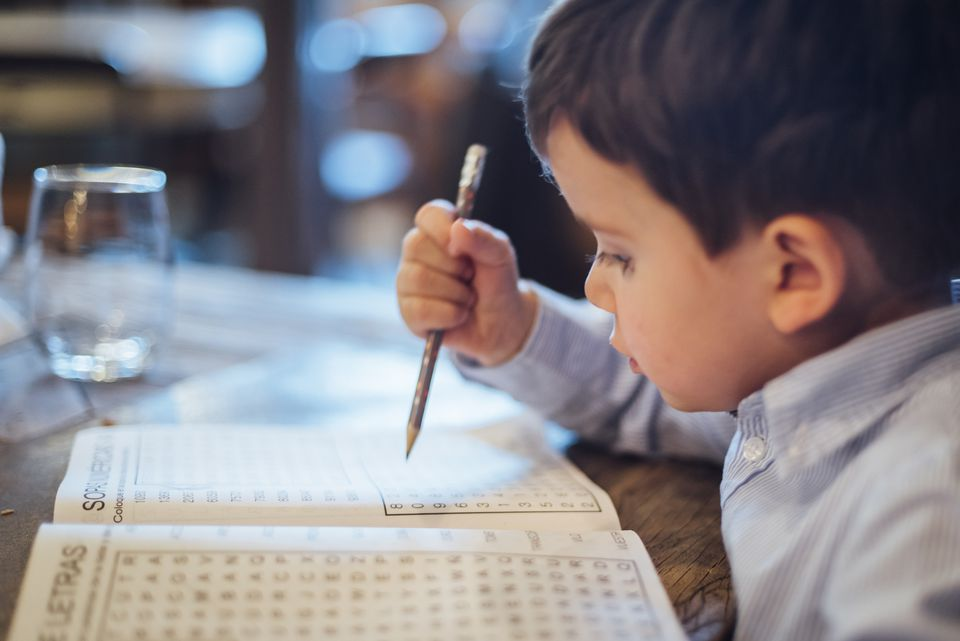 Young boy doing word search puzzle