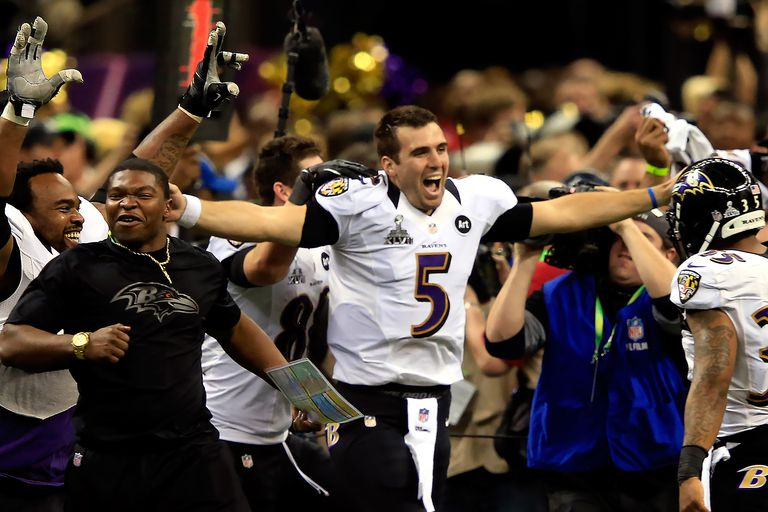 Joe Flacco #5 of the Baltimore Ravens celebreates with his teammates after defeating the San Francisco 49ers during Super Bowl XLVII