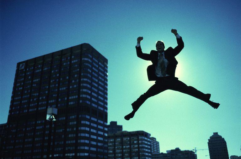 Businessman Jumping in Air
