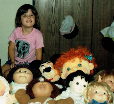 The author, with her pile of plush, including a Mickey Mouse!