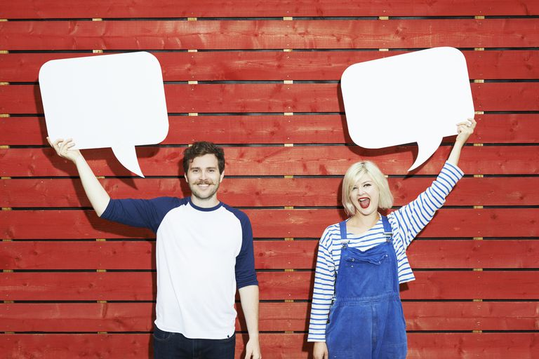 People holding up speech bubbles